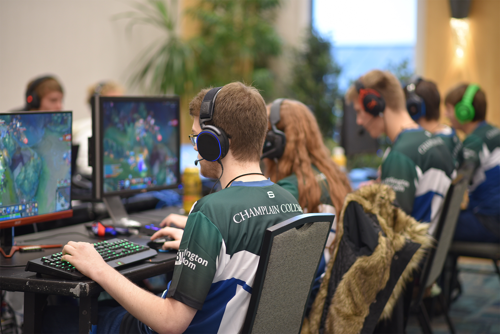 Group of students wearing team uniforms playing Esports games