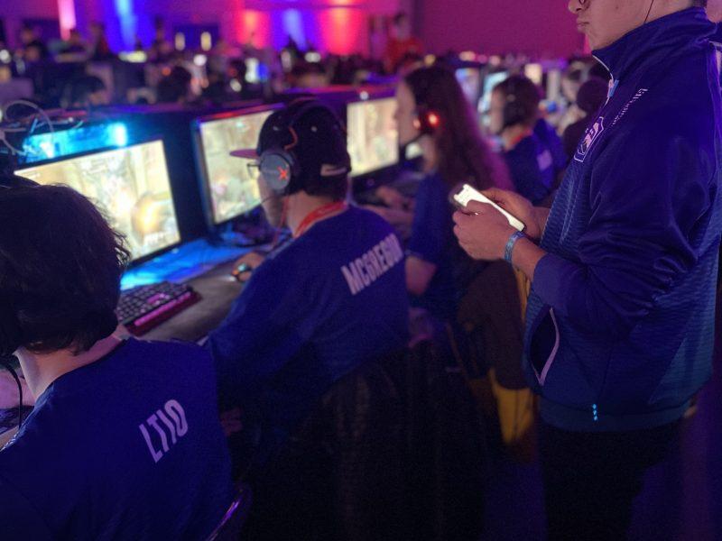 Esports team looking at computer screens