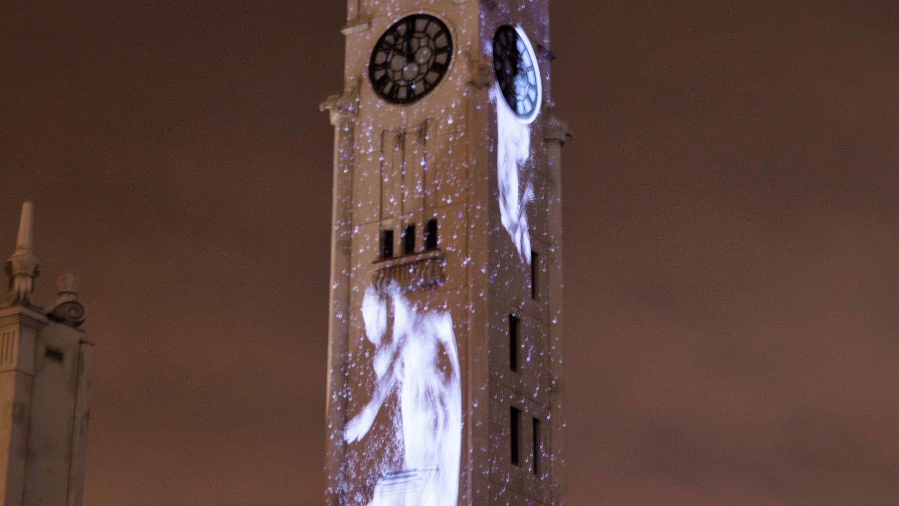 Lit up clocktower at night