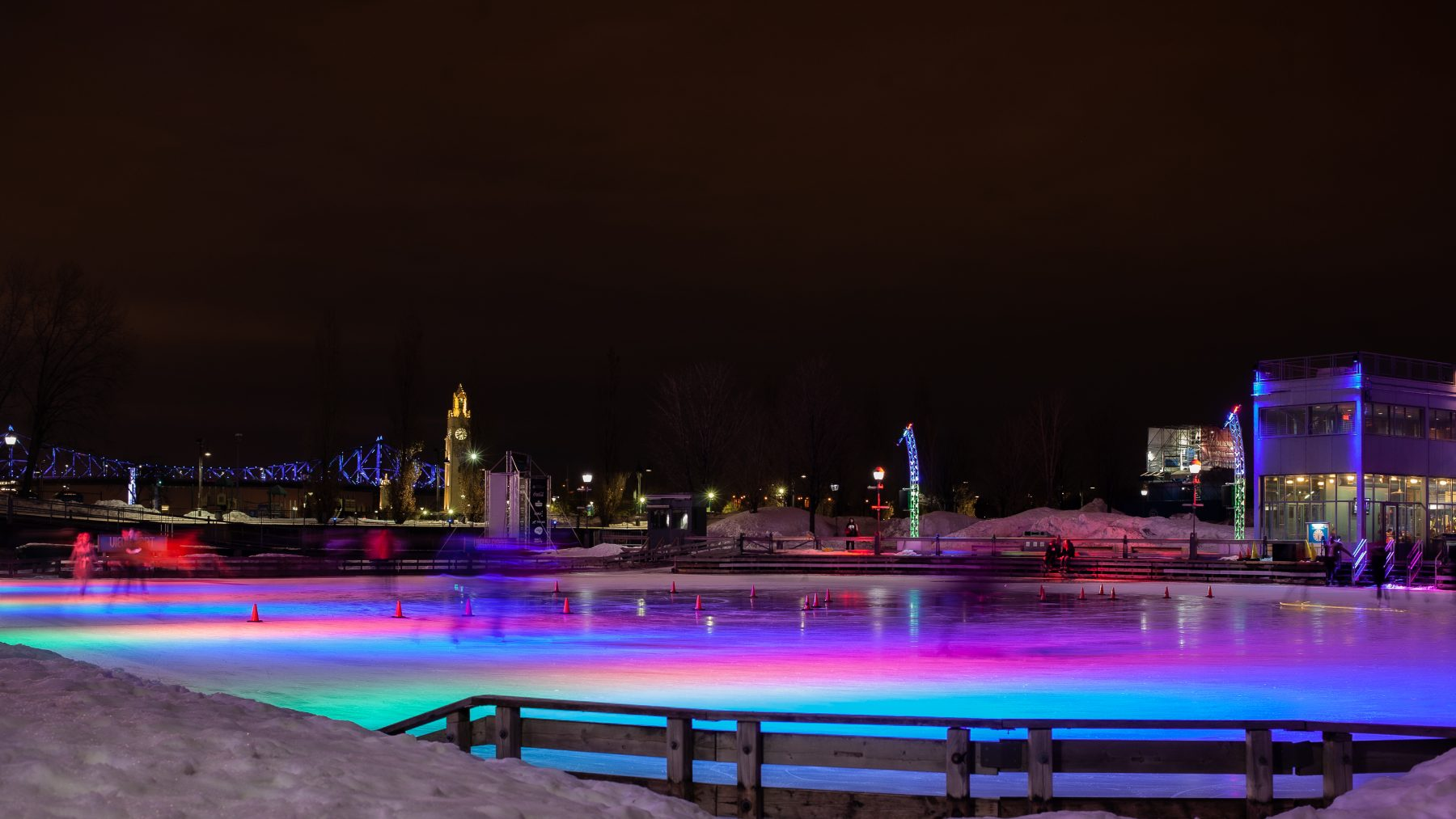 Multi-colored lights shining on an ice rink