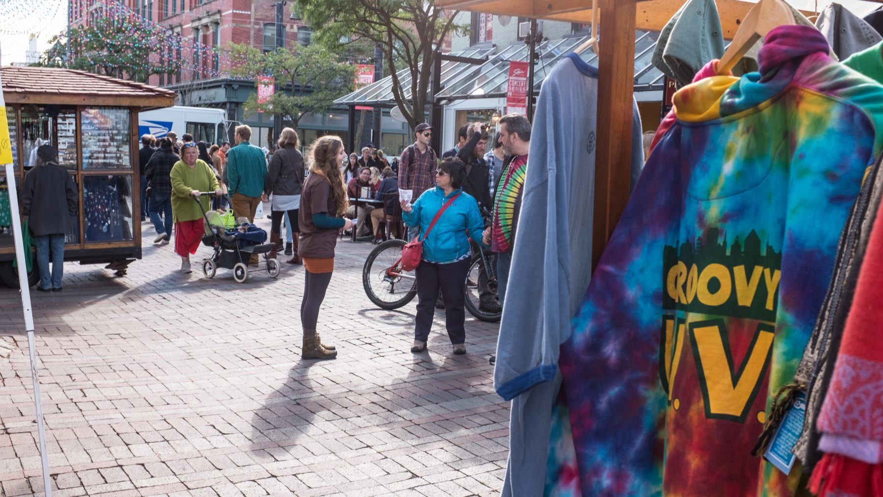People on Church Street with a rack of shirts in the foreground