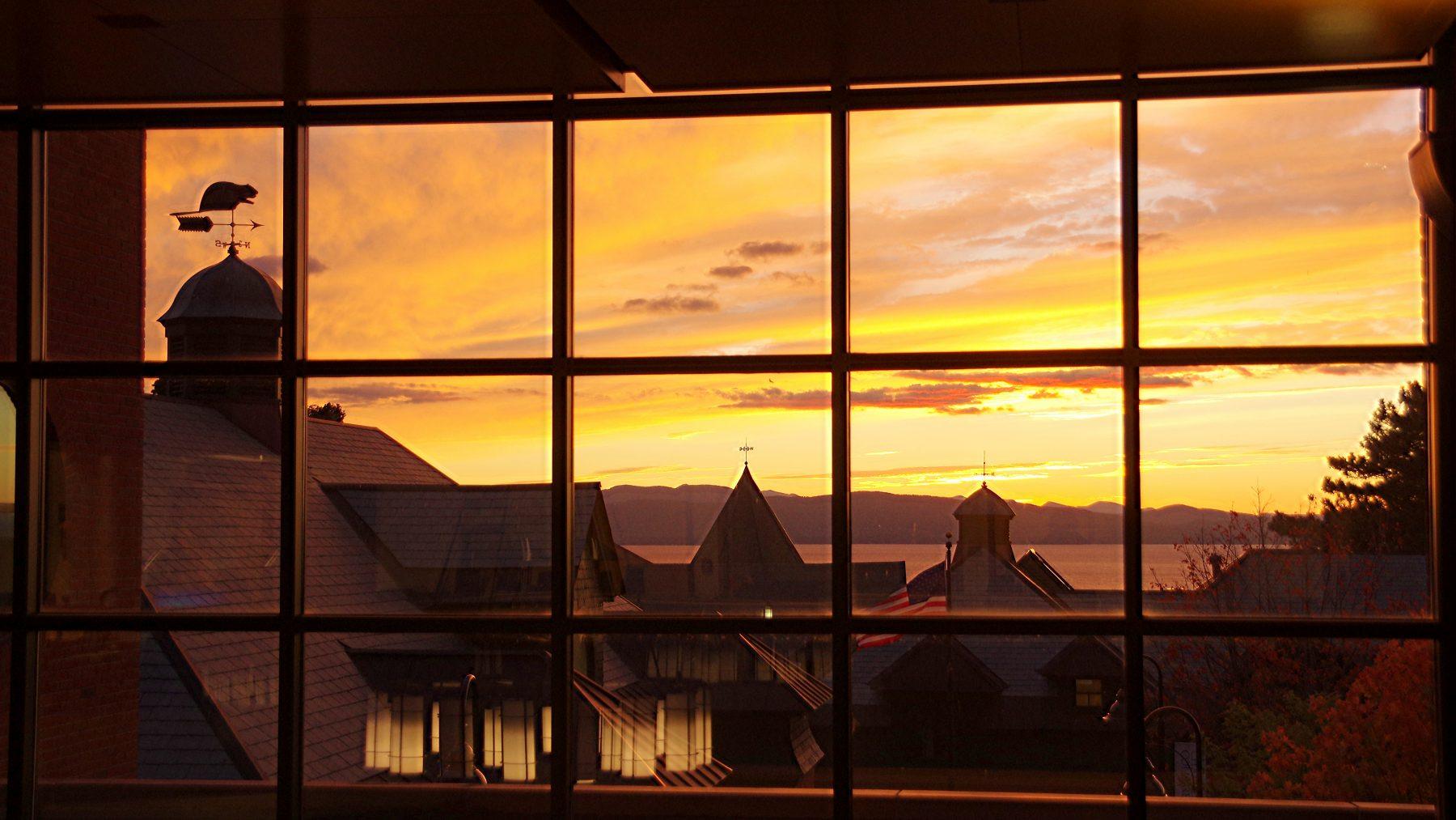 Sunset over Lake Champlain through a windowpane