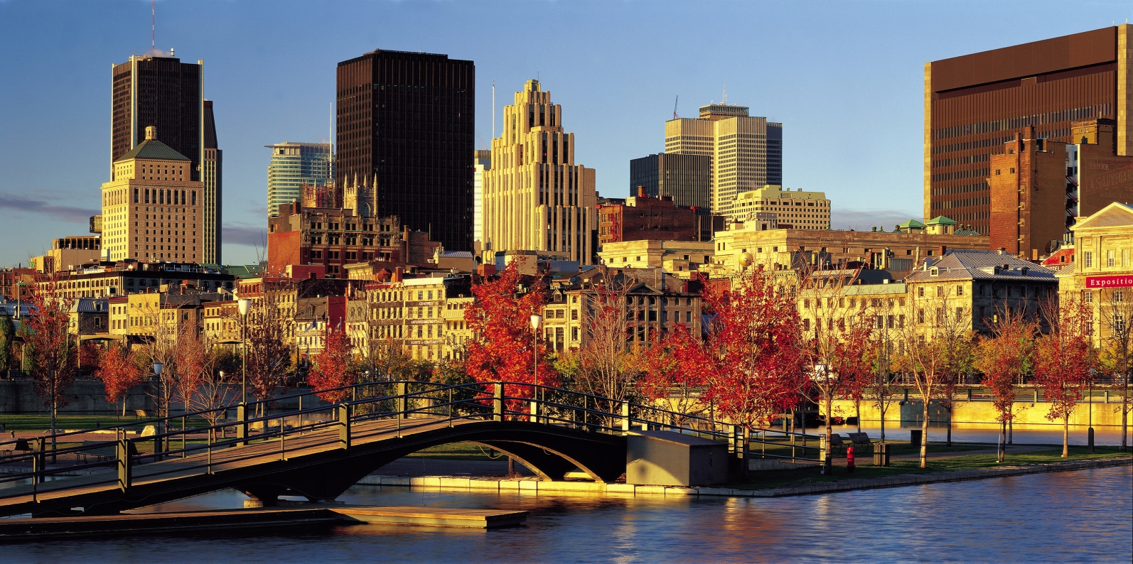 Landscape shot of Montreal with a river in the foreground