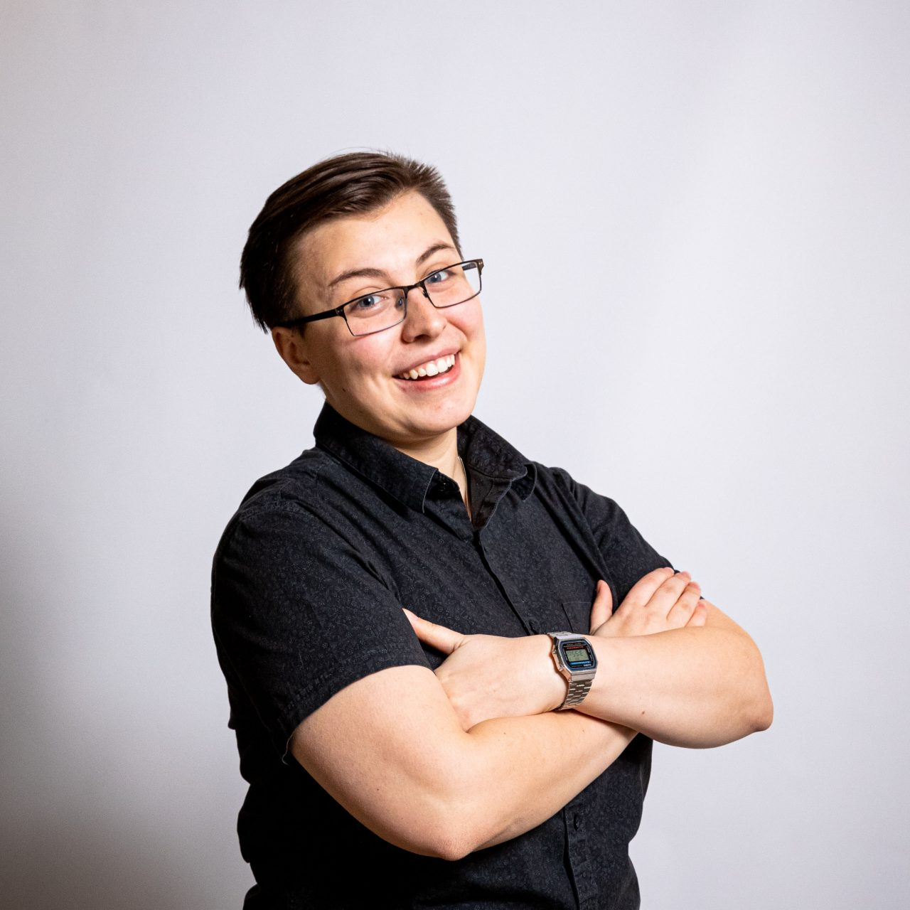 Profile picture of smiling student with arms crossed