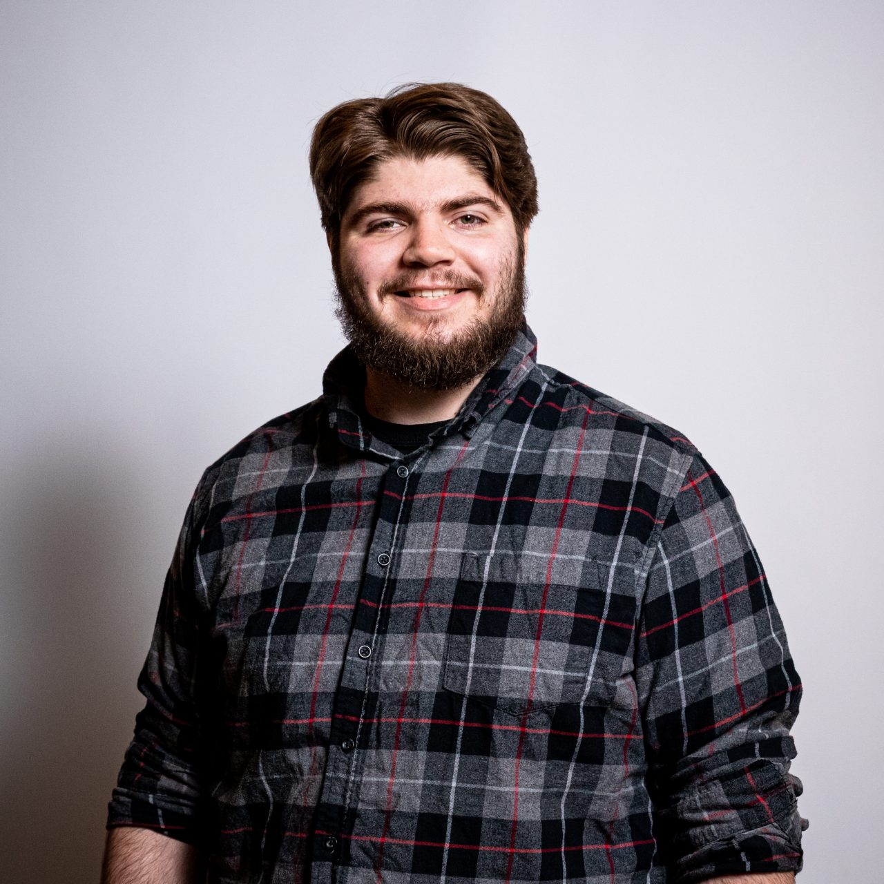 Image of a smiling student at a photoshoot