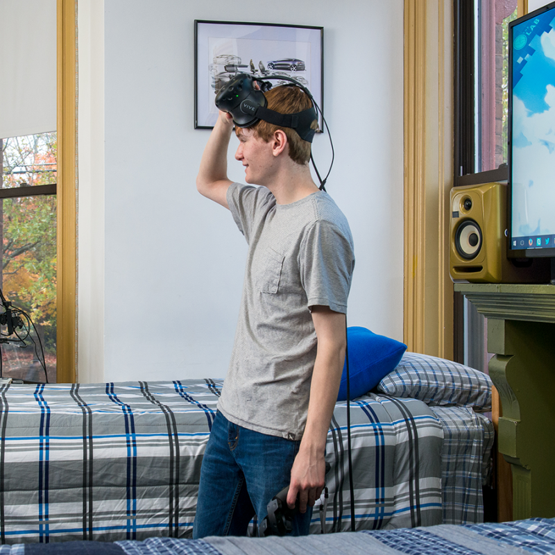Student using VR headset in their dorm