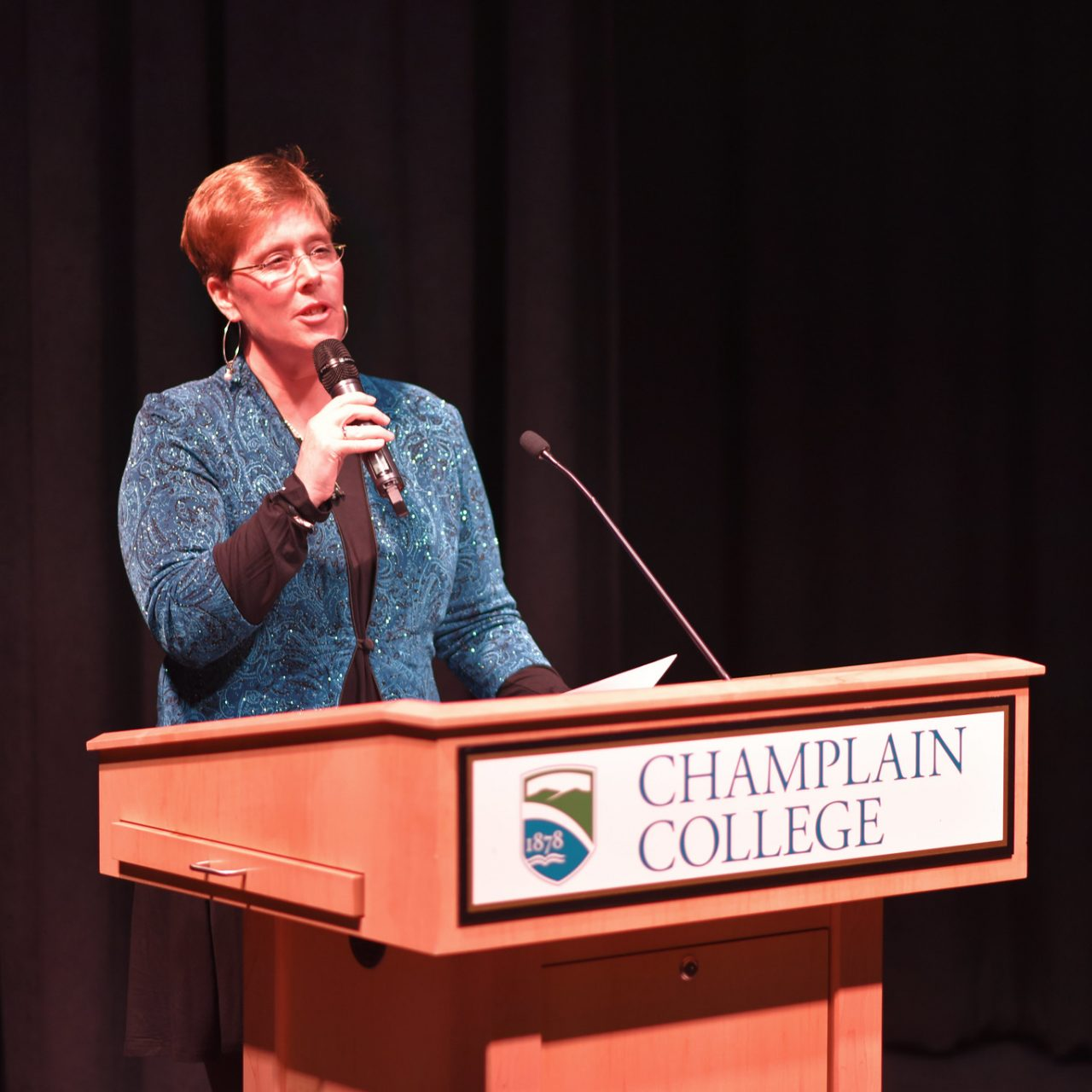Professor speaking at a podium