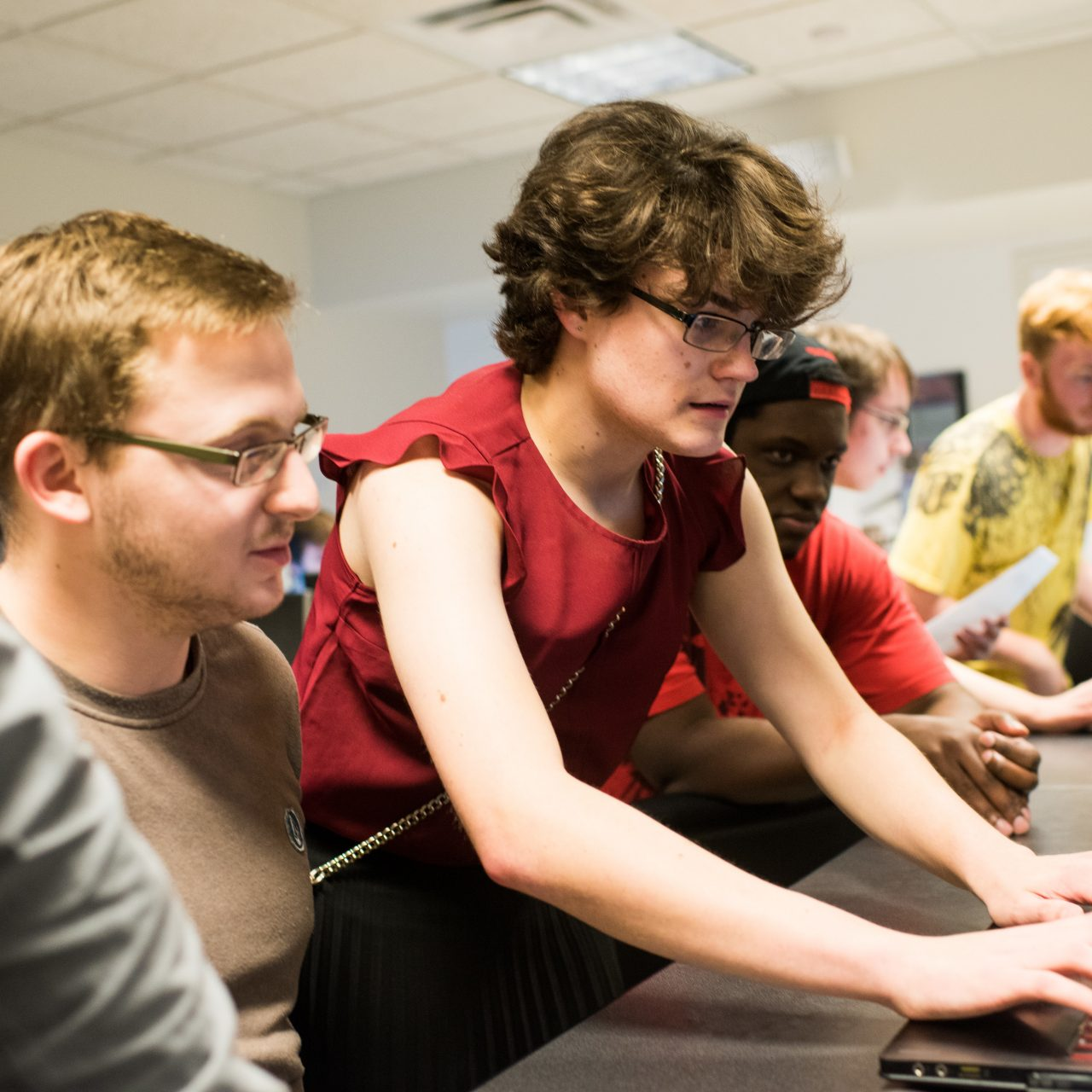 Students working on computers together