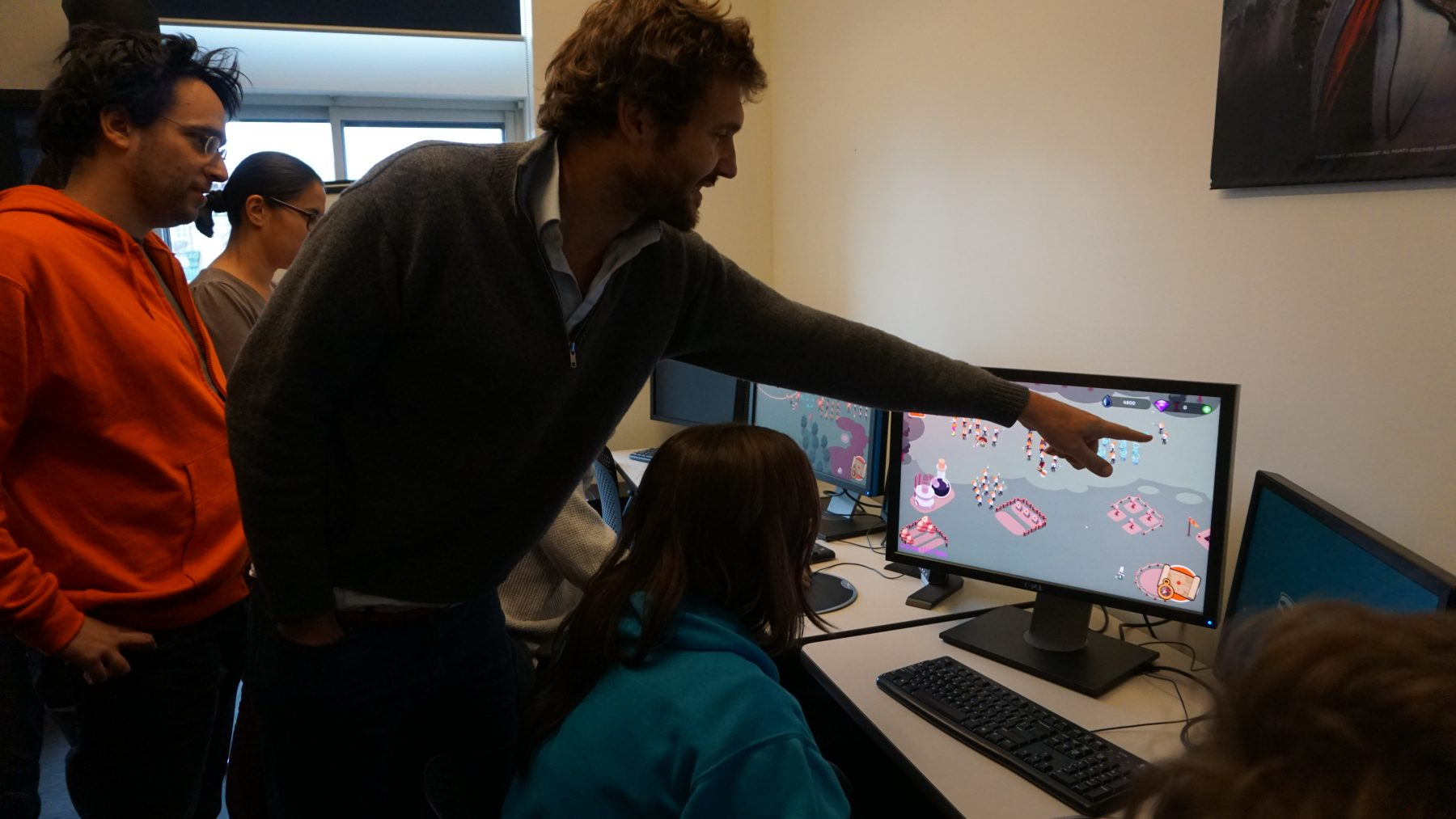 Professor showing student Game Programming