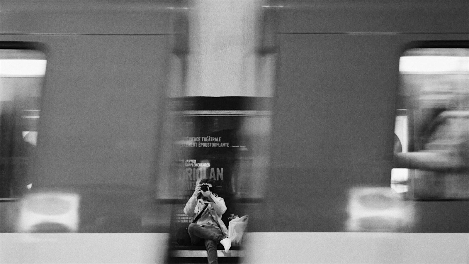 Student taking a photo in a subway station