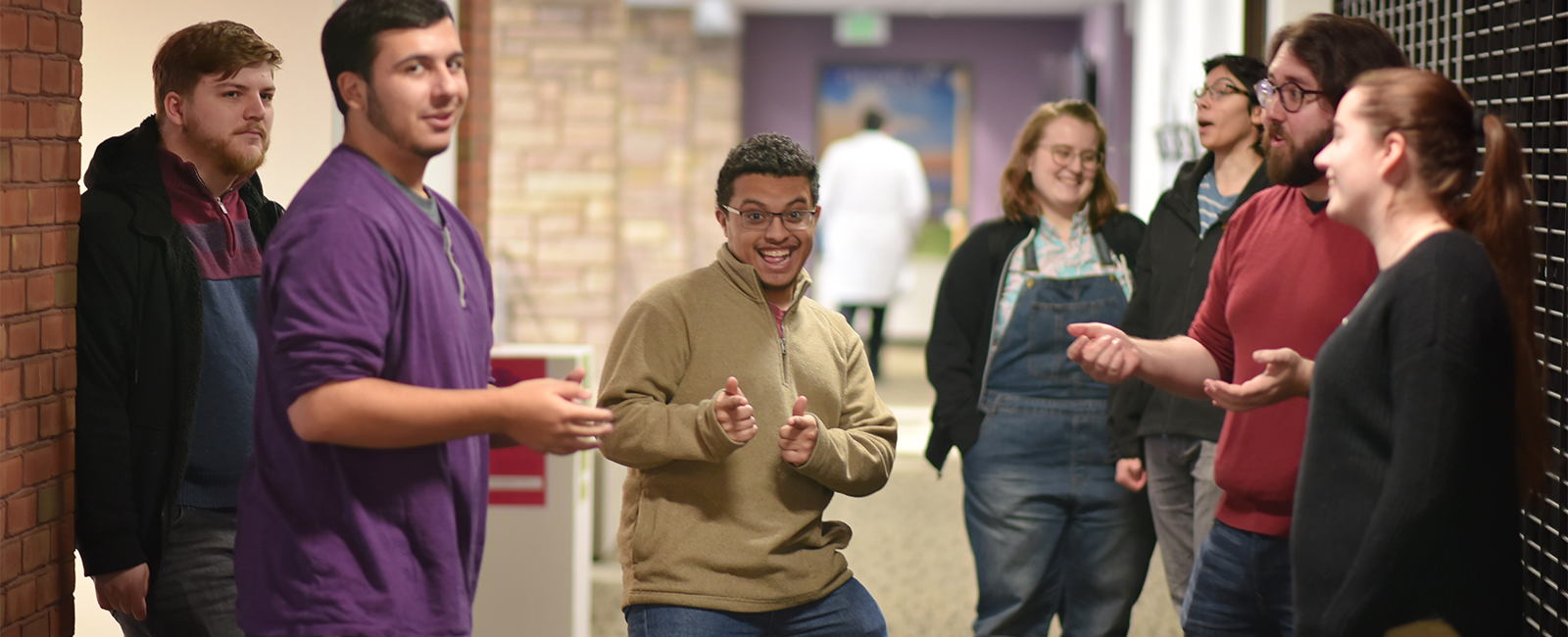 Smiling students in a hallway